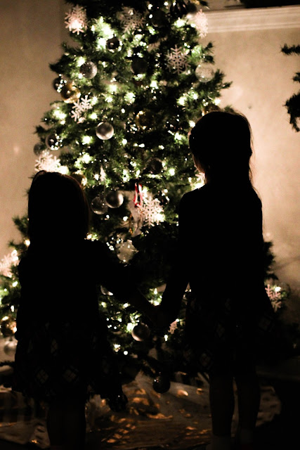 """Magical"" pictures by the Christmas tree"