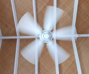 Running ceiling fans help circulate conditioned air