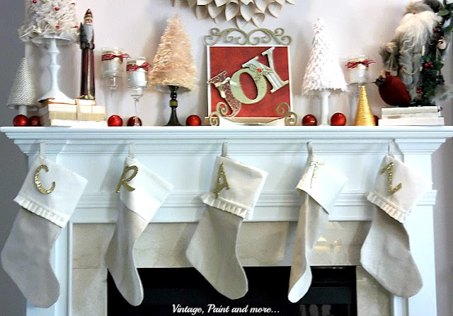 Vintage, Paint and more... Christmas mantel with diy stockings and glittered monograms, diy'd trees of felt, fun fur yarn, silk and gold cords and burlap, vintage Santas, wood and paper JOY sign