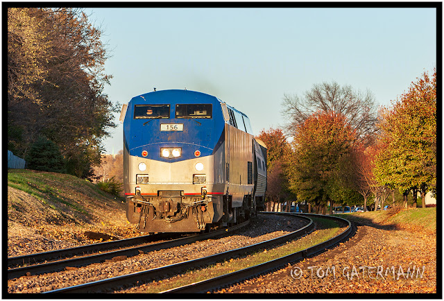 Amtk 156 lead's Amtrak's Ann Rutledge west at Maplewood, MO.