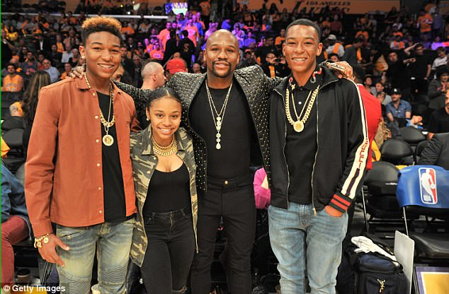 Photo of Floyd Mayweather and three of his children at the LA Lakers game
