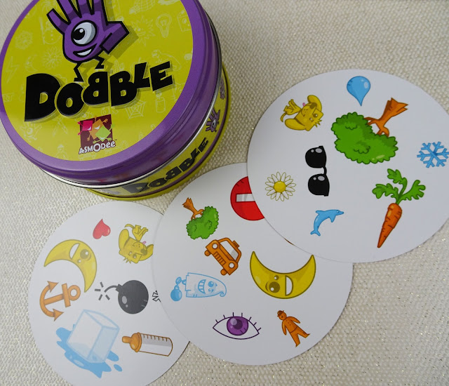 Dobble and cards on white background
