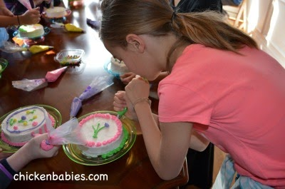 decorating cakes at a tween girl birthday party