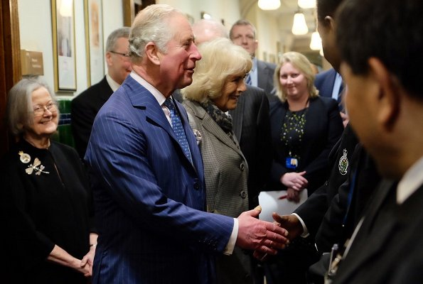 Duchess Camilla wearing her bespoke grey coat dress