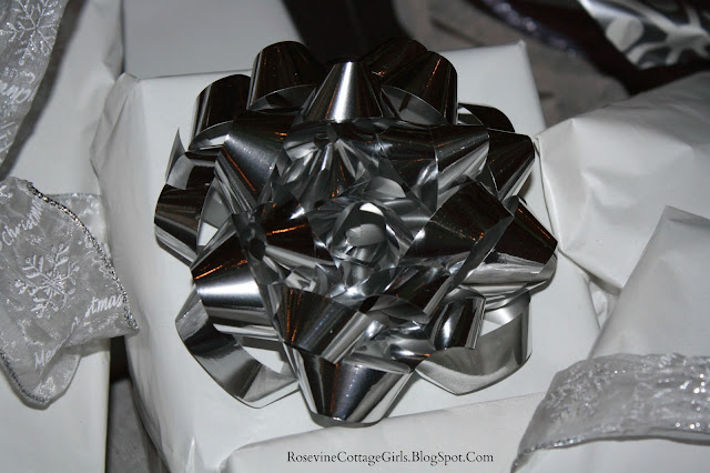 Photo of a package wrapped in white paper with silver ribbon | When the holidays find you empty