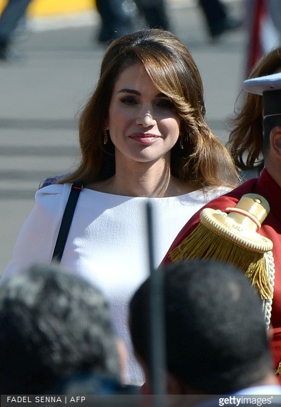 Jordan's Queen Rania attends a welcome ceremony with her husband King Abdullah II at the Royal Palace in the Moroccan city of Casablanca