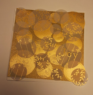 Christmas Card with white and gold vellum circles overlapping the edge
