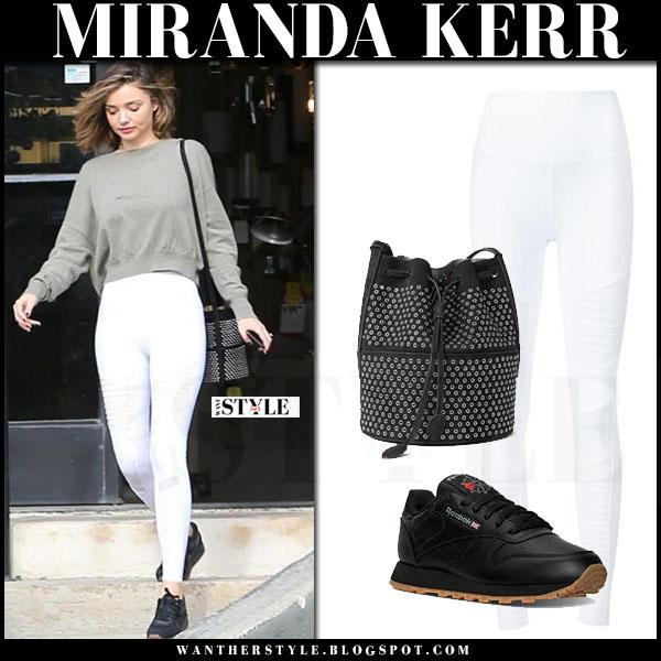 Miranda Kerr in khaki sweatshirt, white alo yoga moto leggings and black sneakers reebok what she wore