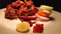 Chicken Tikka serve with lemon onions pomegranate seeds beetroot for Kandhari chicken Tikka recipe