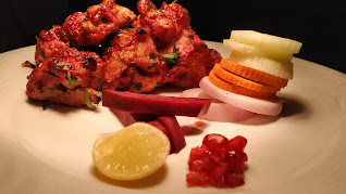 Chicken  serve with lemon onions pomegranate seeds beetroot for Kandhari chicken  recipe
