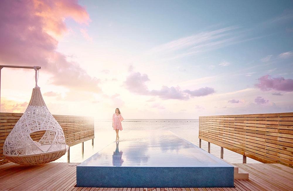 LUX* South Ari Atoll Pool Water Villa at Sunset