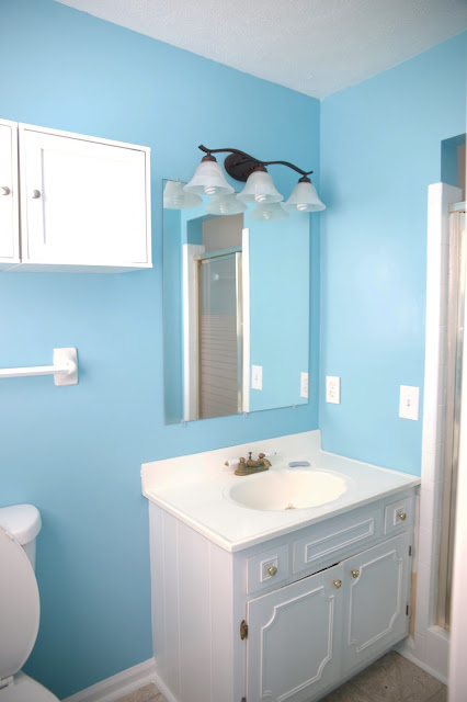 Blue bathroom before