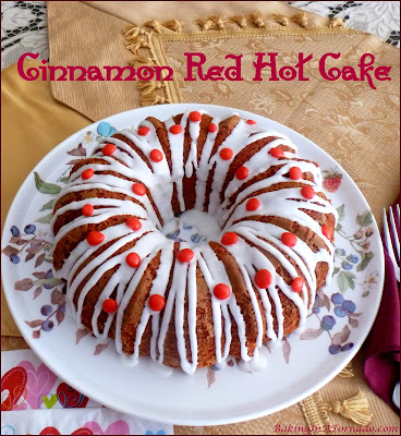 Cinnamon Red Hot Cake is simple to make, change up a boxed cake mix with cinnamon flavors, add a drizzled topping studded with red hots. | Recipe developed by www.BakingInATornado.com | #recipe #cake #ValentinesDay