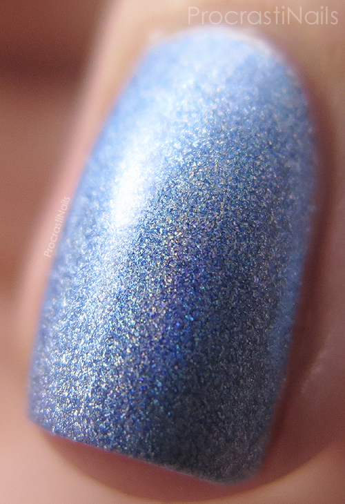 Macro swatch of the blue holographic polish Julep Tali