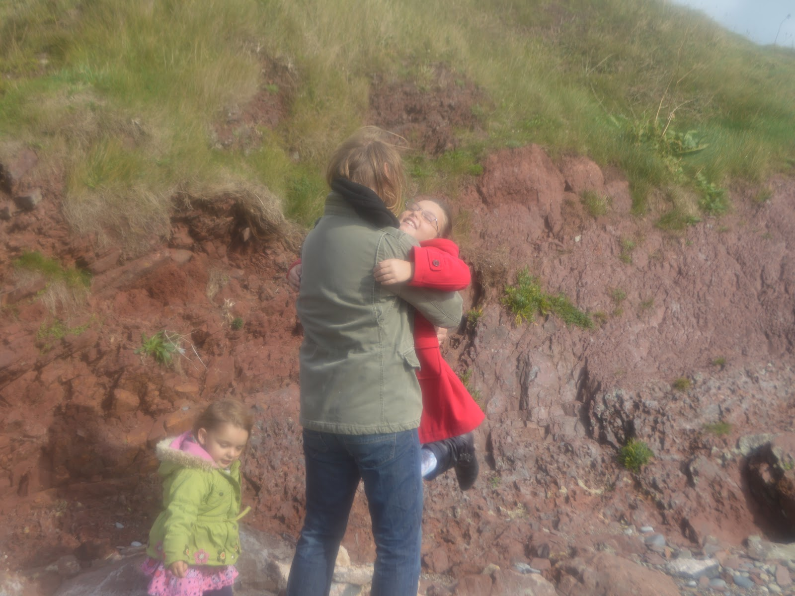 Father and Daughter Hug on Manorbier Beach Pembrokeshire
