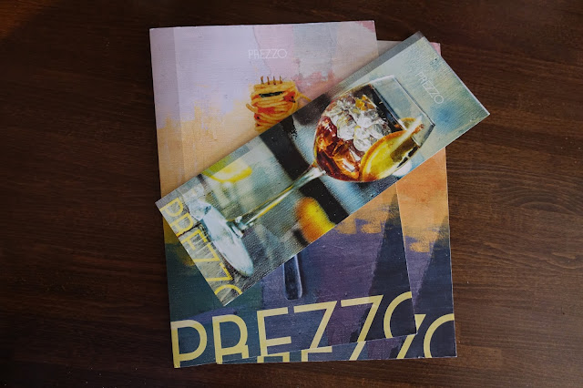 A couple of Prezzo menus with a drinks menu on top