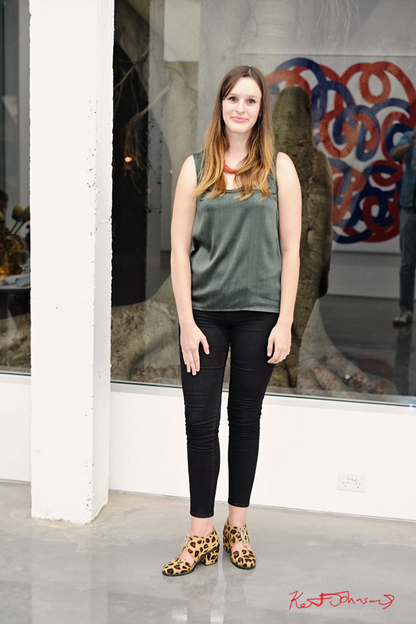 Leopard print shoes, black jeans green shift blouse, red bead necklace - Sarah Cottier Gallery