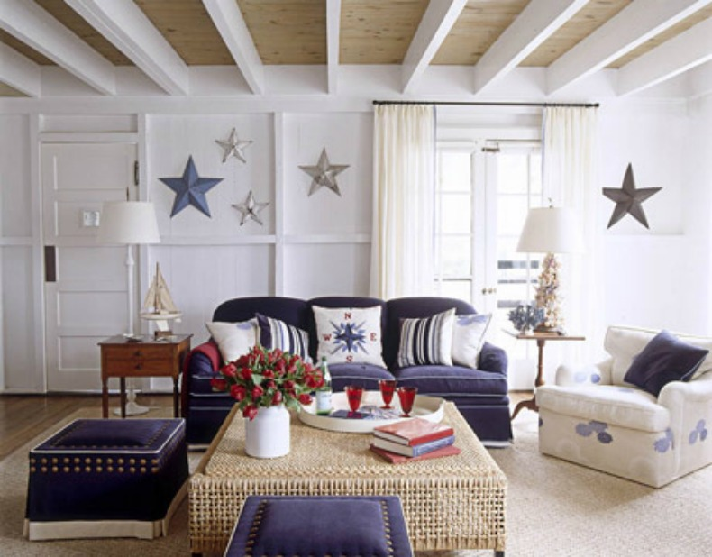 Coastal navy slipcover sofa, rattan coffee table and beautiful nautical touches
