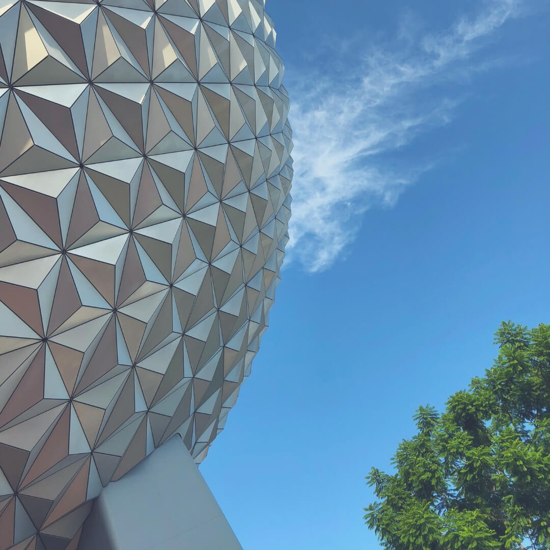Top 7 Things To Do At Epcot, Walt Disney World | Spaceship Earth against a blue sky.