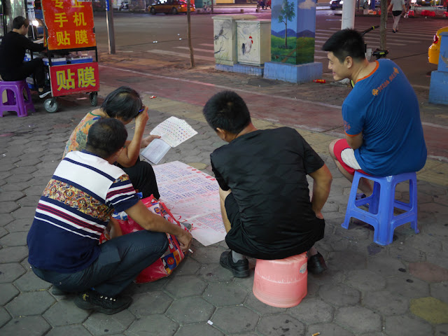 woman figuring out fortunes in Zhongshan, China