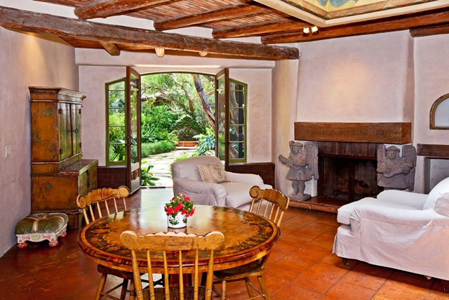 One of the rooms with fireplace and wooden furniture at Mel Gibson's house