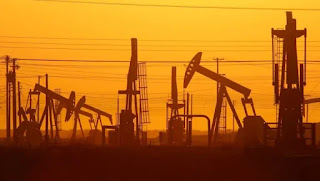 Pump jacks are seen at dawn in an oil field over the Monterey Shale formation in California in 2014. (Credit: David McNew/Getty Images) Click to Enlarge.