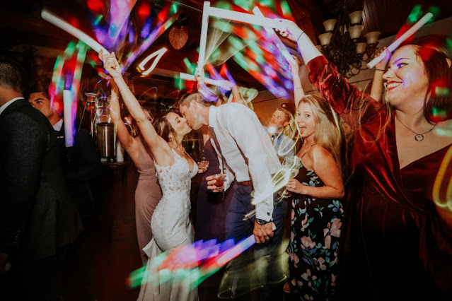 bride and groom partying with guests