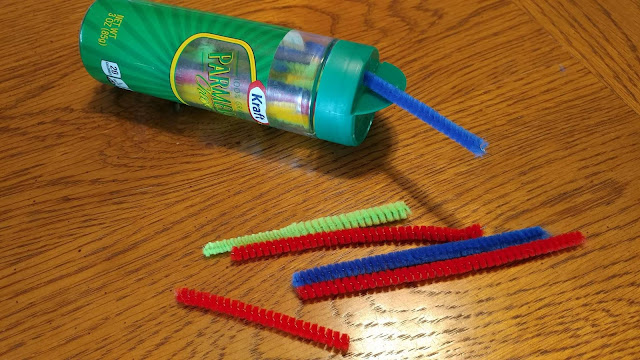 Pipe cleaners in a cheese container