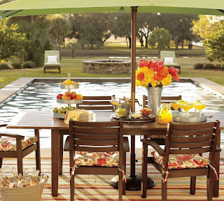 cosy pottery barn patio and rectangular outdoor pool feats beautiful flower as table centrepiece also green parasol
