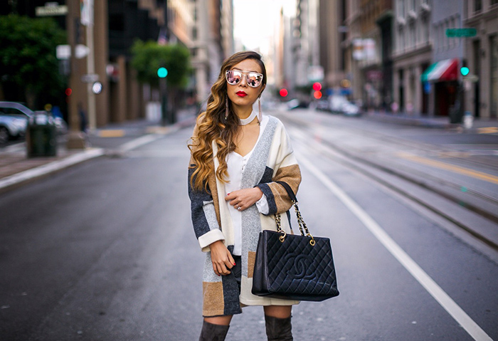 Colorblock cardigan, patchwork cardigan, wayf cutout top, leather mini skirt, over the knee boots, baublebar earrings, statement earrings, quay sunglasses, chanel grand shopping tote, san francisco street style, san francisco fashion blog