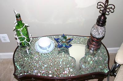 Bonita mesa forrada con Cds reciclados