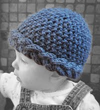 Toddler wearing blue Simple Hat with a Twist knit hat.