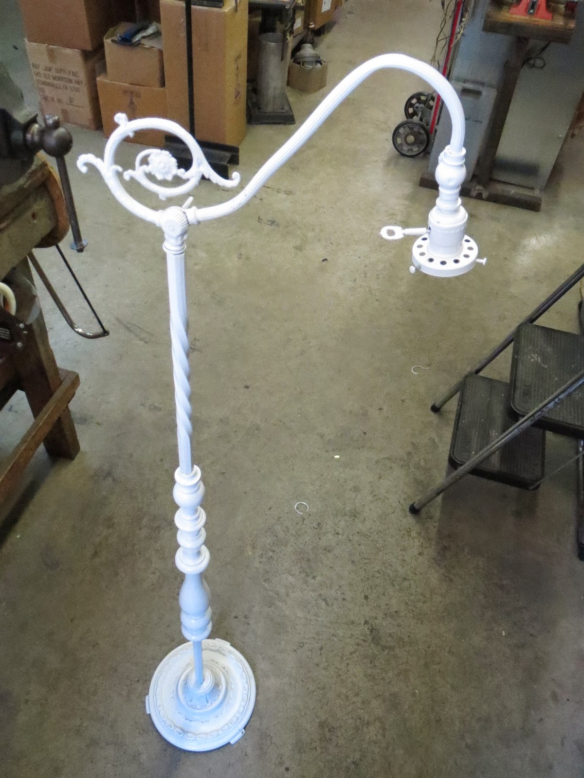 Lamp parts and repair lamp doctor white bridge arm floor lamp the first thing we need to do is take the bridge arm off the lamp this lamp has two swivels one on each end of the lamp arm mozeypictures Choice Image