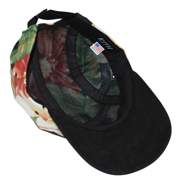 """3b175af49a3 ... brim and a special """"Just Wolves"""" tag that mixes the Raised by Wolves  namesake with the KITH slogan of """"Just Us."""" The hats vary in floral print  placement ..."""