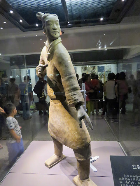 Terracotta Warrior behind glass in Pit 2 of the Terracotta Army near Xi'an China