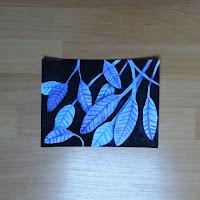 aquarelle de feuilles sur fond sombre
