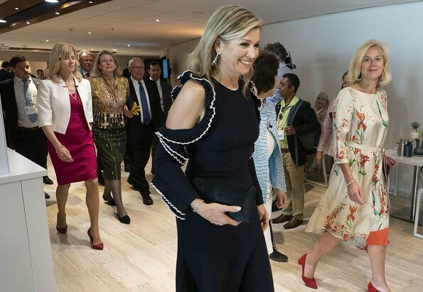Queen Maxima wore Oscar de la Renta Cold-shoulder ruffled wool mid dress. The Queen wore a midi dress by Oscar de la Renta