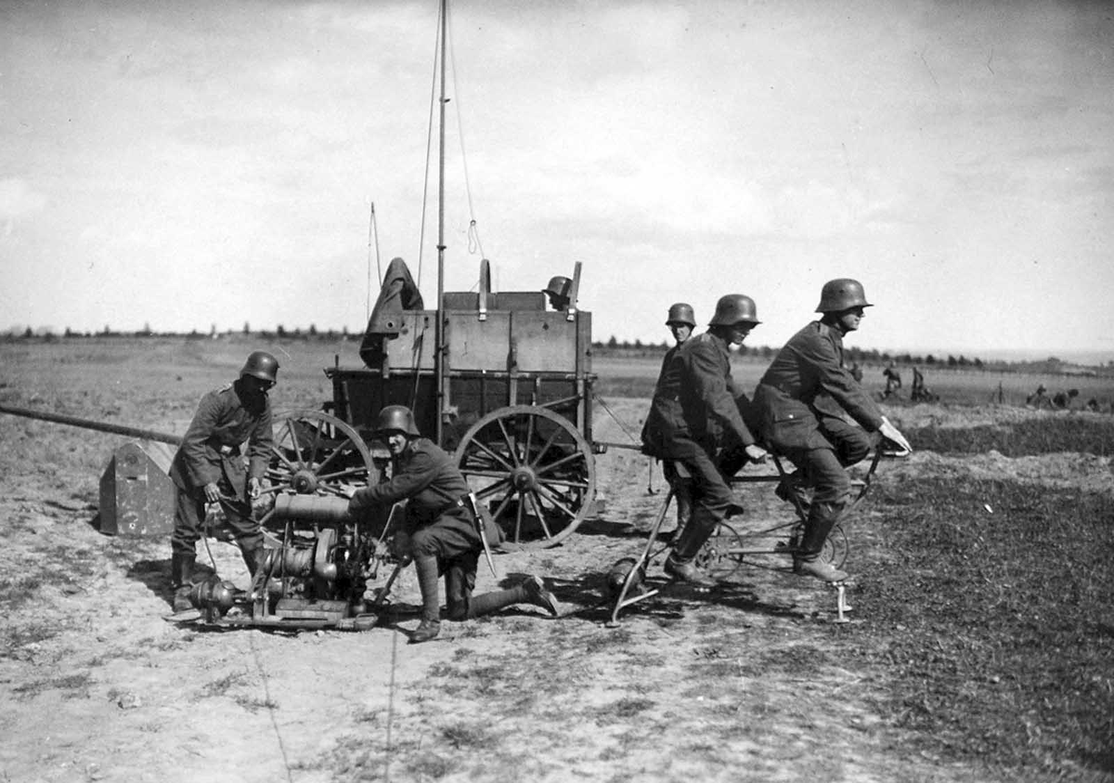 A German communications squad behind the Western front, setting up using a tandem bicycle power generator to power a light radio station in September of 1917.