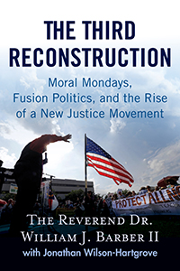 Book cover, 'The Third Reconstruction.' Image depicts person standing on outdoor stage with microphone in front of a crowd. An American flag is on display and a banner partially reads, 'Protect All N-'