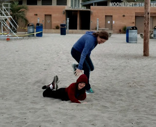 parent and child play in sandbox