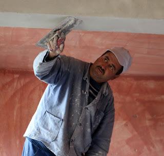 The face of a man at the end of a long day of plastering