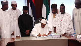 President Buhari signing the 2016 Budget
