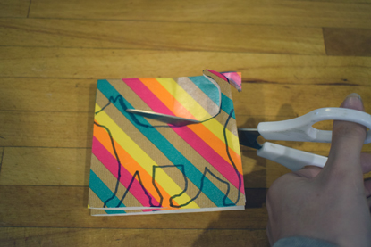 cutting out cat shape from multi-coloured paper