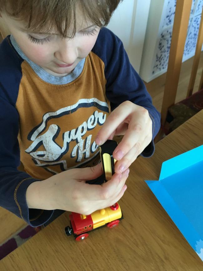 boy-undoing-screw