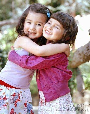 Cute Friends Hugging Each Other