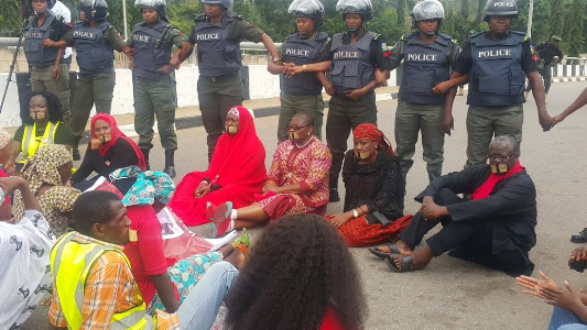 Photos: Police stop #BringBackOurGirls group from entering Aso Rock