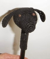 http://www.ravelry.com/patterns/library/umbra-the-wonder-dog-pencil-topper