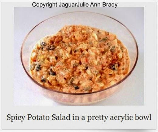 spicy potato salad in pretty acrylic bowl