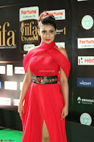 Apoorva in a Stunning Tight Leg Split Sleeveless Red Gown at IIFA Utsavam Awards 017.JPG