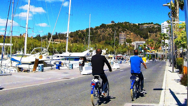 Bike around Muelle Uno in a sunny day
